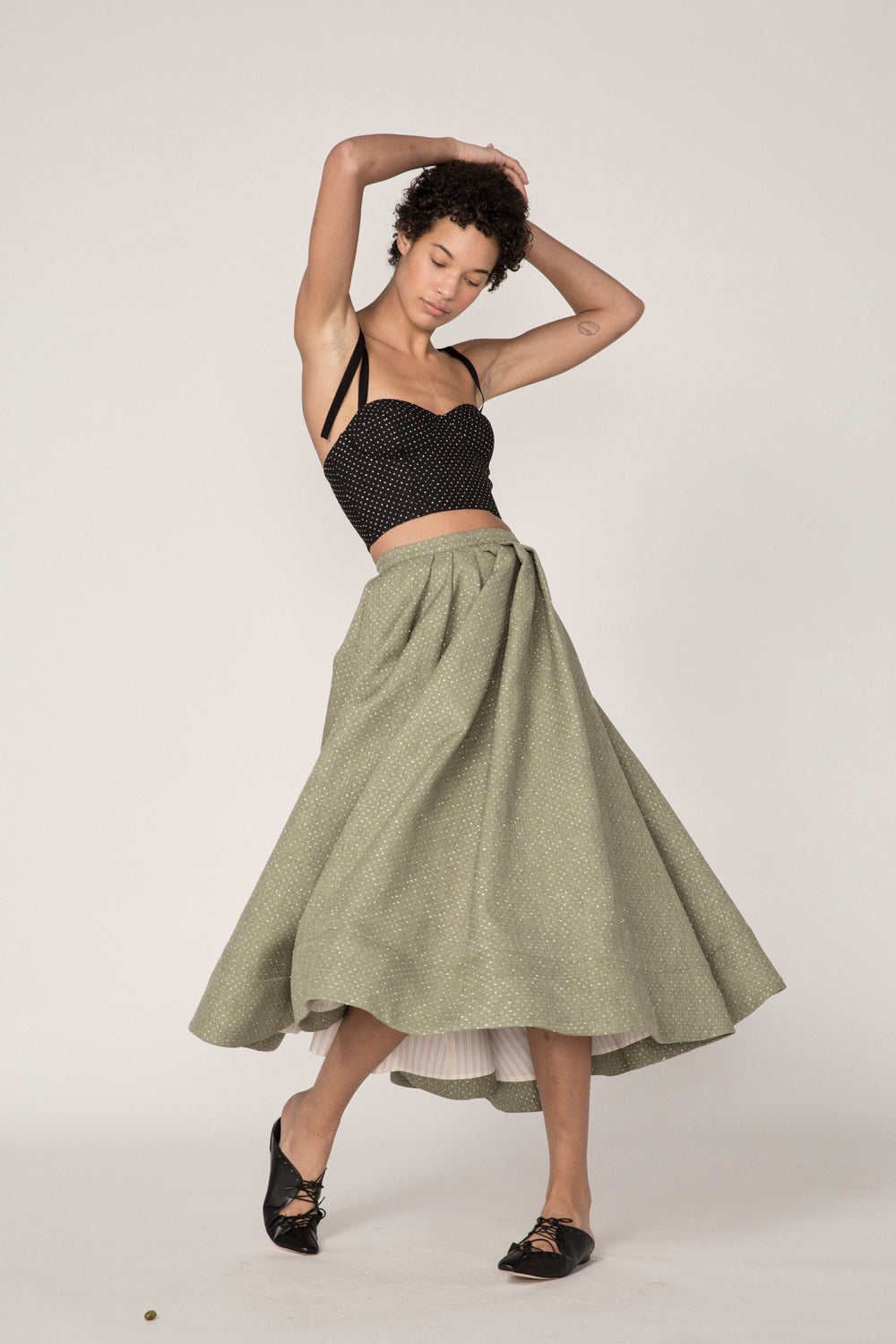 Rosie Assoulin Fall 2019 Full A-Line Skirt. A-line midi skirt. Glitter polka dots. Flared hem. Striped lining. Green. 66% Polyester, 34% Cotton. Sizes 0 - 12.