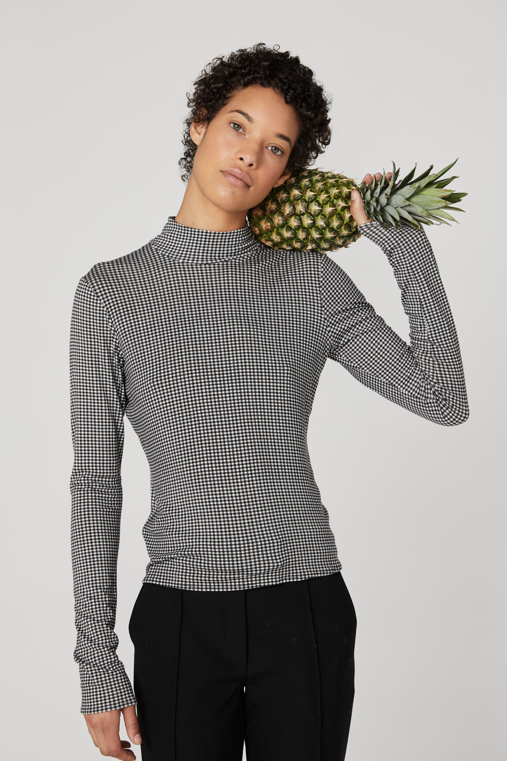 Rosie Assoulin Fall 2019 Turtleneck Top. Long-sleeve jersey mockneck. Zipper in back. Black plaid. 95% Viscose, 5% Elastane. Sizes 0 - 12.