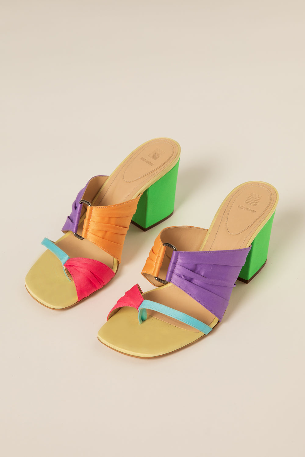 Rosie Assoulin Fall 2019 Pleated Funky Toe Mules. Chunky heeled mules. Toe loop. Open buckle detail. Rainbow. Sizes 35 - 41.