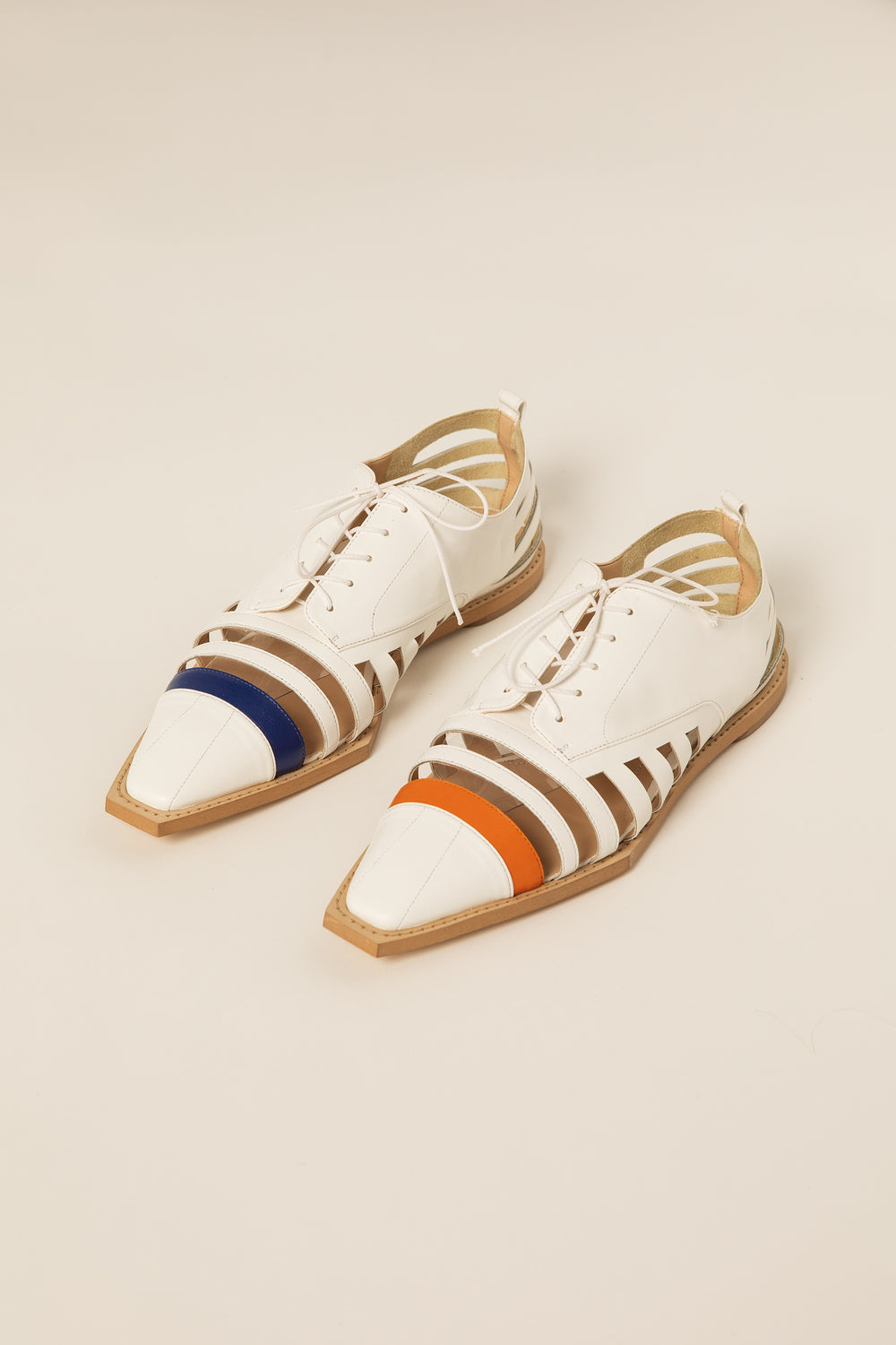 Rosie Assoulin Fall 2019 Oxford with Laser Cut Stripes. Classic oxford with cutout stripes. Adjustable laces. Square toe. Black. Sizes 35 - 41.