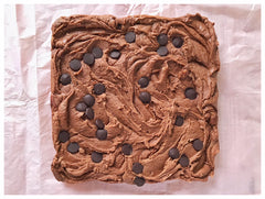 A slab of double chocolate fudge on pink tissue paper