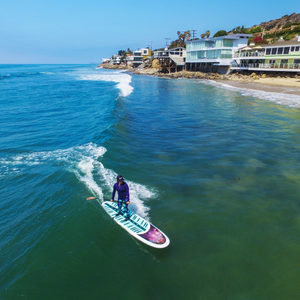 Surfing a stand up paddle board in california