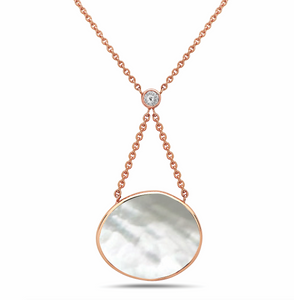 irini expression necklace, mother of pearl paired with bezel set diamond, keeps your intuition clear and focused on the forward.