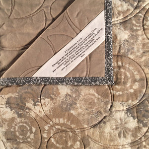 Comfort Quilt in tan, cream and grey stylized fossil print