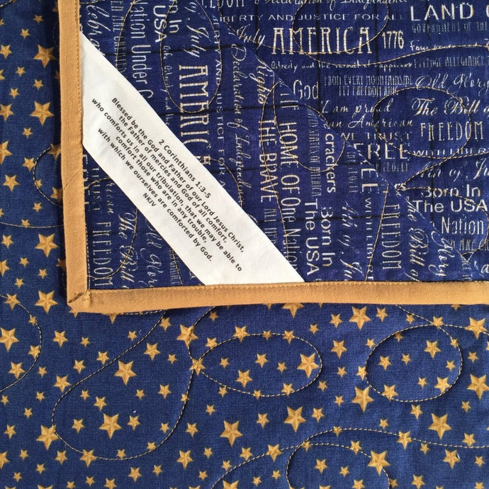 Comfort Quilt in gold stars on navy blue print fabric