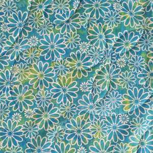 Comfort Quilt in teal daisy print fabric