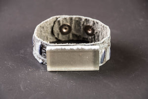 Grey leather cuff with glass rectangle stone