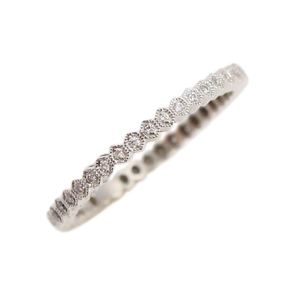 Delicate Diamond Eternity Band in 18t White Gold
