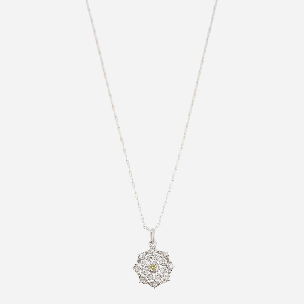 Antique style diamond pendant with yellow sapphire accent