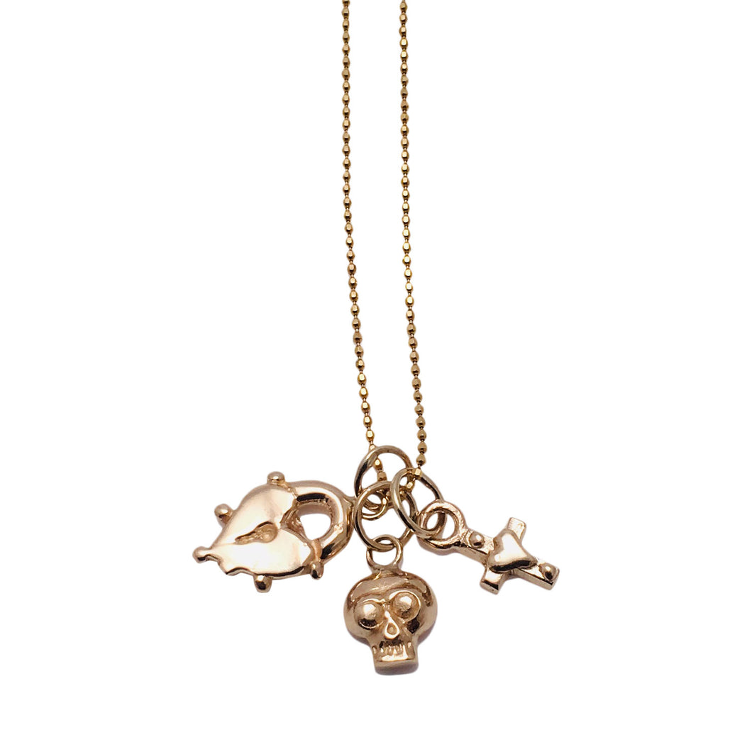 Gold Necklace with triple gold charms; Heart shaped gold lock, gold skull and mini gold Heart cross