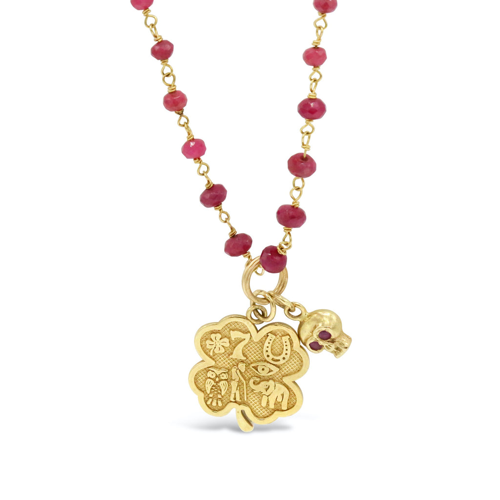 18 kt gold Ruby Rosary with Engraved Clover Pendant and Ruby Eyed Skull Necklace