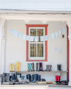 Porch with mudboots and welcome banner