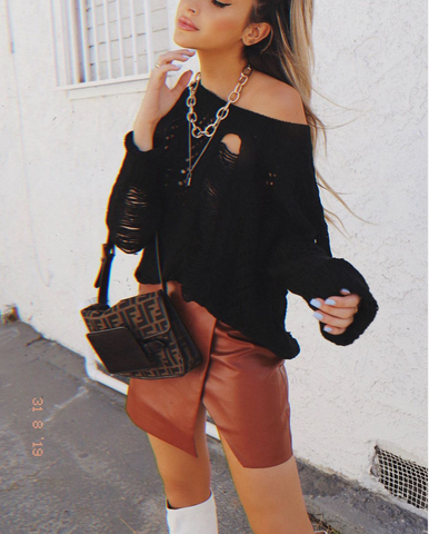 black sweater with chain necklace