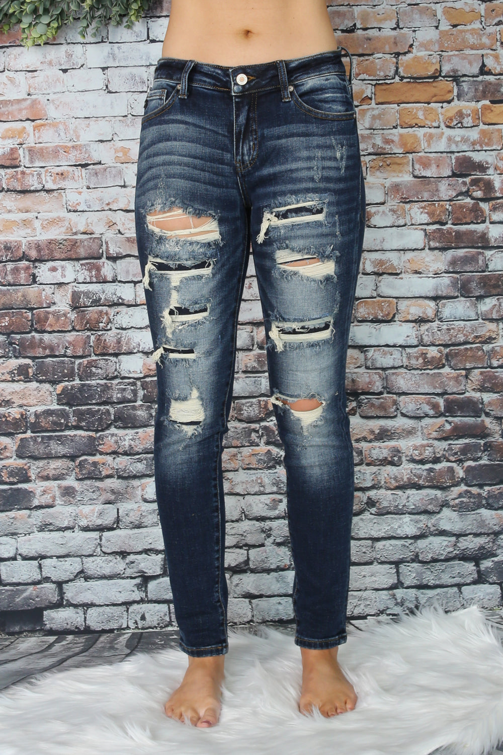 heavy distressed ankle jean