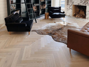 The Unique Beauty of a Wall-to-Wall Herringbone Floor