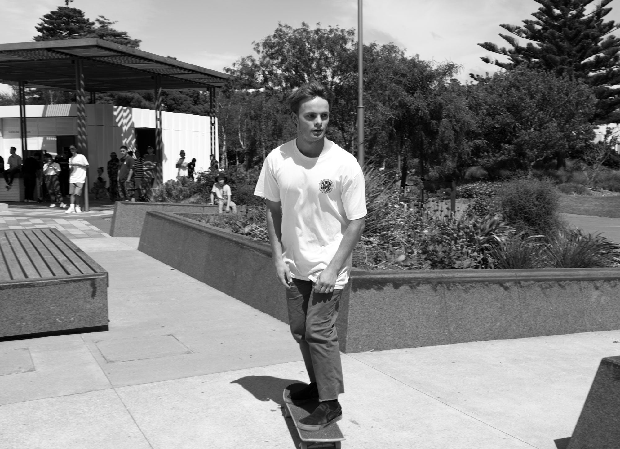Skateboarder in white Empire tee