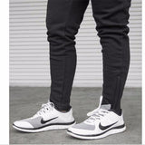 SPANDEX ELASTIC TRACK PANTS WITH ZIP-UP ANKLES