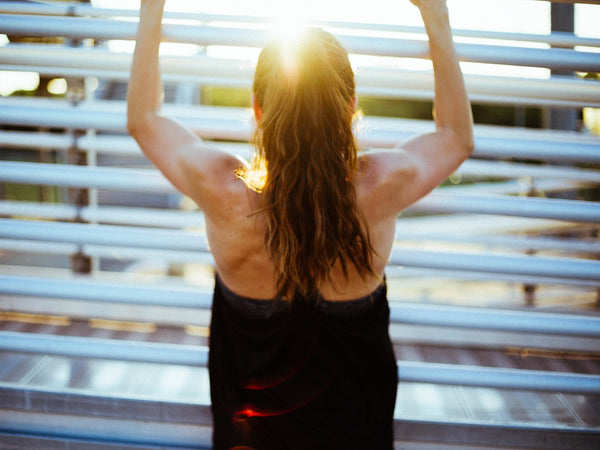 girl working out by the sunlight