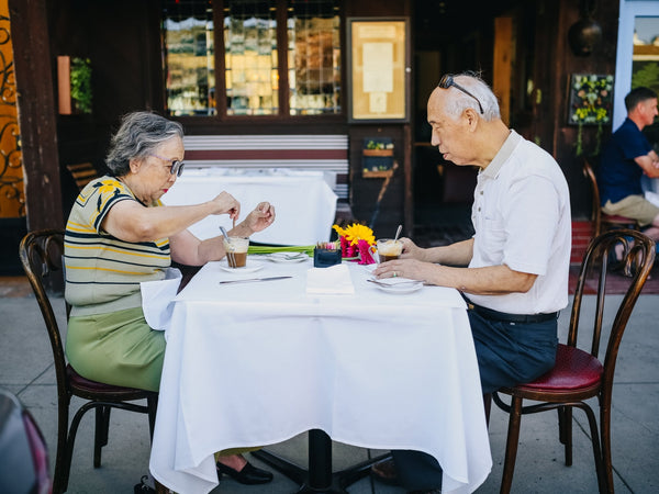 old couple date eating in a restaurant