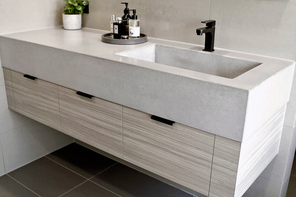 Vanity with single integrated basin