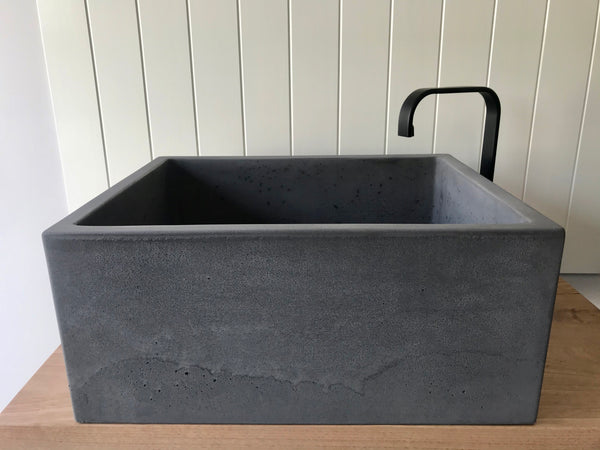 Handmade concrete laundry trough in Storm