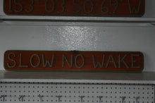 SLOW NO WAKE sign - Alaska Rug Company