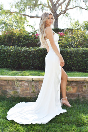White satin bridal dress with leg slit