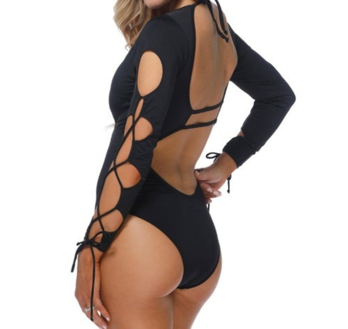Black 1 piece long sleeve swimsuit.
