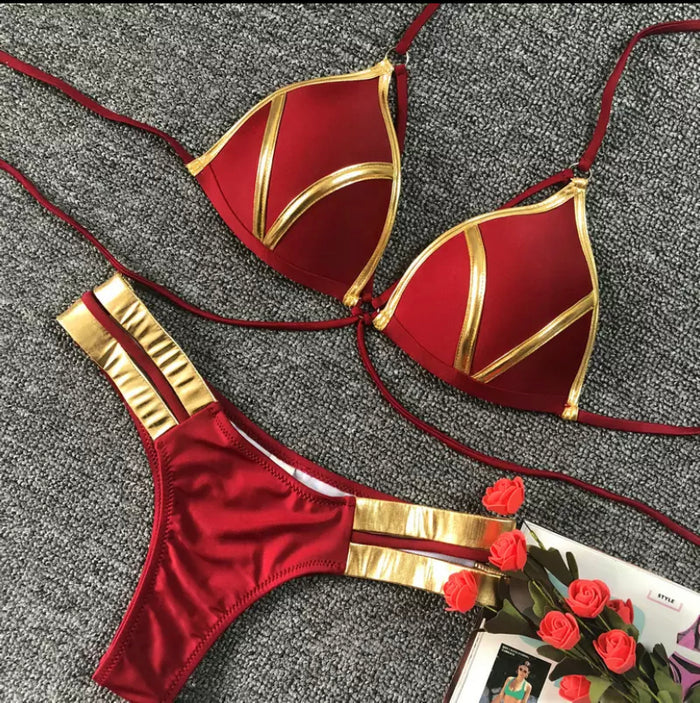 Maroon 2 piece gold trim swimsuit.