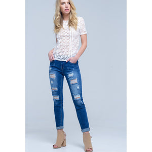 Jean with shredded rips and raw-cut cuffs