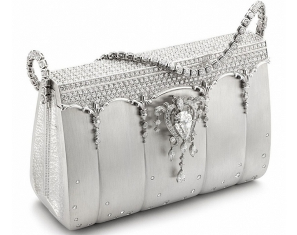 4f6fb845490e Hence the bag can be used as a clutch and strap as a necklace.The bag  itself is encrusted with 8 karat pear shaped dazzling diamond that can also  be used ...