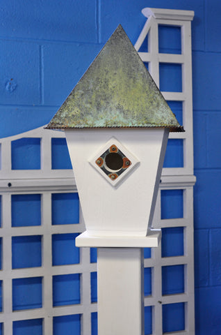 A Pad With A Patina Birdhouse