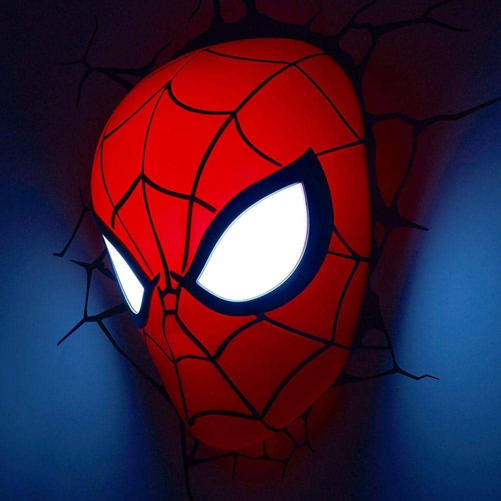 Red Spider-Man Mask LED Wall Light, Illuminating a Blue Wall Surface