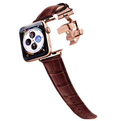 gold apple watch with mahogany brown leather band for men