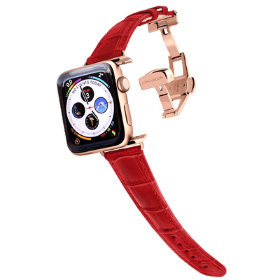 gold apple watch with crimson red leather band for women