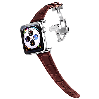 silver apple watch with mahogany brown leather band for women