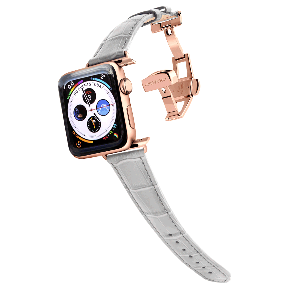 gold apple watch with misty gray leather band for women