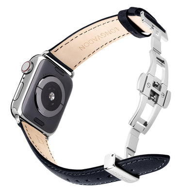 silver apple watch with black leather band for women back view