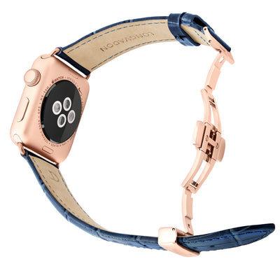 gold apple watch with navy blue leather band for men back view