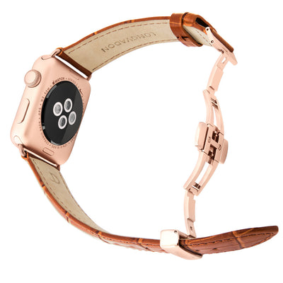 gold apple watch with whiskey brown leather band for men back view