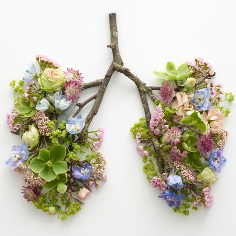 The human lungs made up of twigs and beautiful colourful flowers.