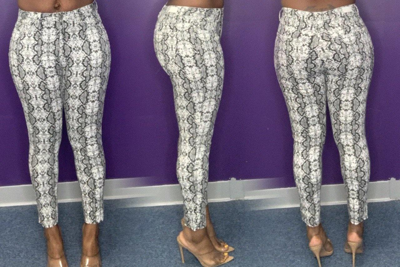 Low rise snake print jeans
