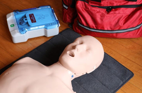 First Aid dummy, medical bag, and AED trainer