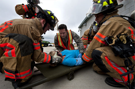 Fire fighters and first responders, first aid with patient