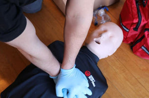 CPR being performed on a First Aid Dummy