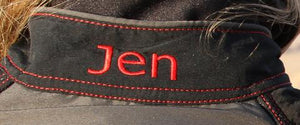 Name embroidered at collar