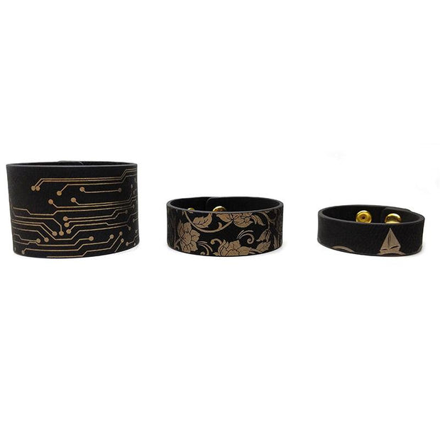 black and gold leatherette bracelets