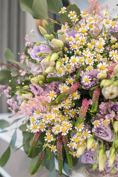 Flower bouquet with lilac and chamomiles