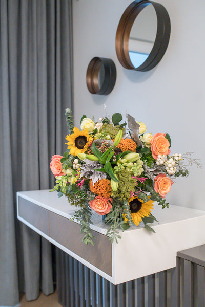 Bouquet of sunflowers, lilies and roses