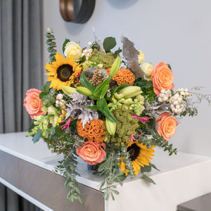 Sunflowers, lilies and roses bouquet
